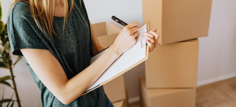 Woman going through moving checklist