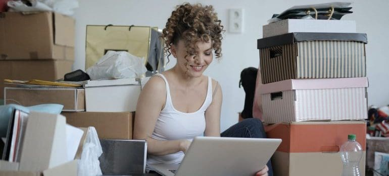 woman using laptop in a mess
